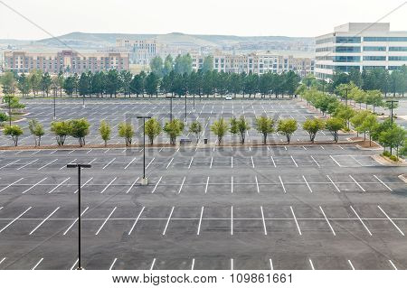 Large Empty Parking Lot With One White Car