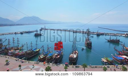 ALANIA - AUG 16, 2015: Many touristic vessels in Alania Sea Port at summer sunny day. Aerial view videoframe