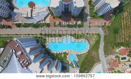 ALANIA - AUG 12, 2015: Pools near edifices of My Marine Residence hotel at summer sunny day. Aerial view videoframe