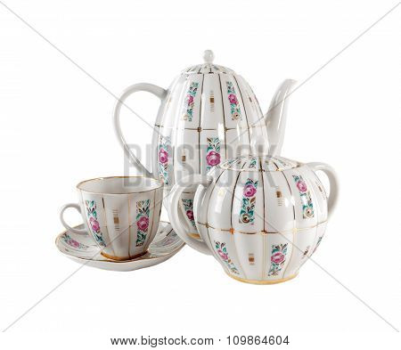 Porcelain teapot, teacup and sugar-bowl with floral roses ornament in retro style isolated on  whit