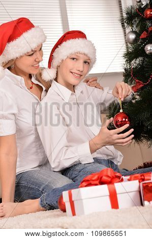mom and son in santa hats
