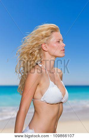 portrait of a sexy girl in white bikini