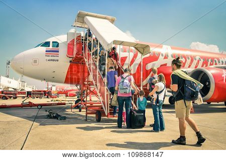 Bangkok, Thailand - 8 February, 2014: International Tourist People Boarding On Air Asian Airplane Bo