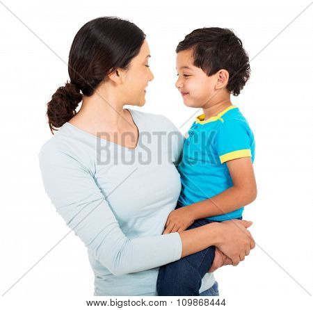 beautiful indian mother and son looking at each other on white background