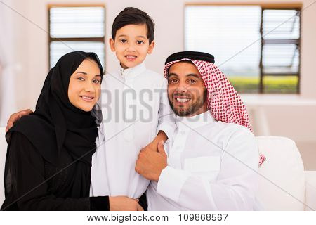lovely muslim family relaxing at home