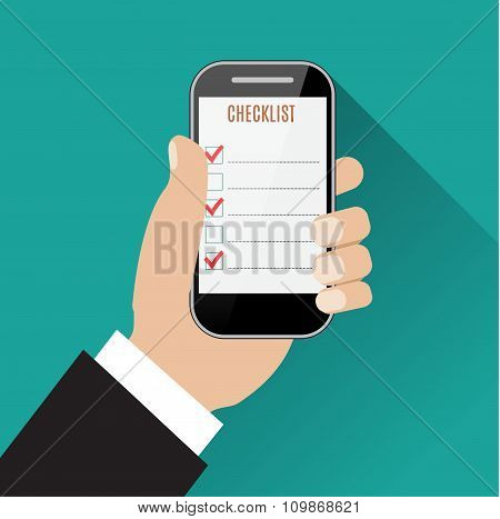 Hand holding smartphone with checklist
