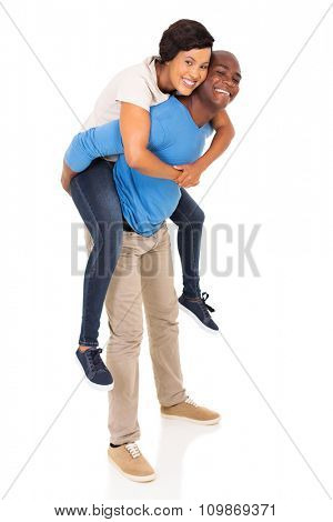 playful african american couple piggyback on white background