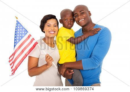 portrait of young african american family with a USA flag