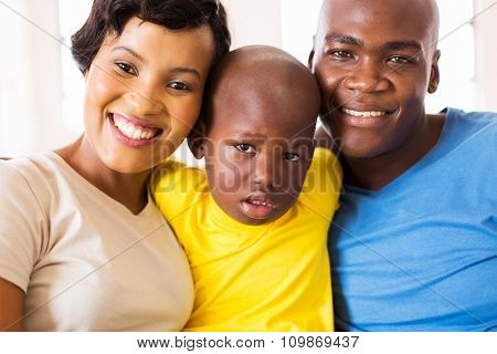 cute african family of three face closeup portrait at home