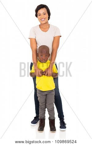 attractive african mother and son standing together on white background