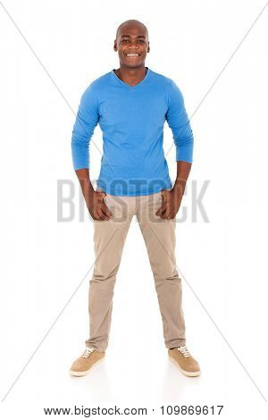 handsome young african man standing on white background