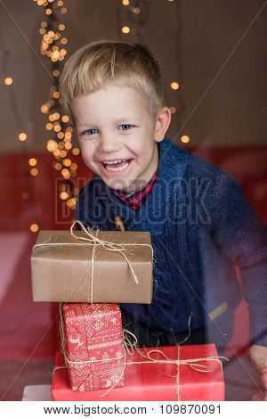 Happy Young Blond Boy with Gift Box. Christmas. Birthday