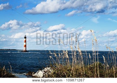 Lighthouse By The Beach