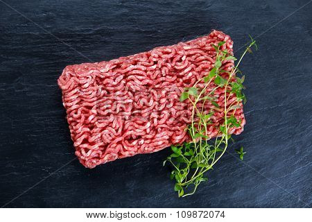 Fresh raw minced beef on old blue stone background.