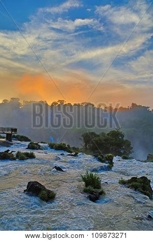 Sunset over famous Iguazu falls on the border between Argentina and Brazil