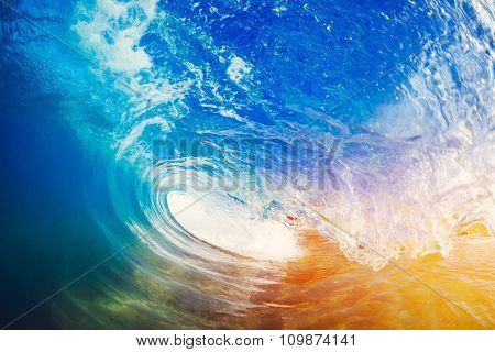 Blue Ocean Wave Crashing at Sunrise