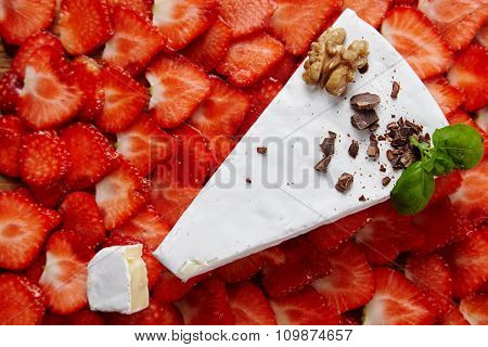 Brie Cheese On Sliced Strawberry Layer Topped With Honey And Crushed Chocolate