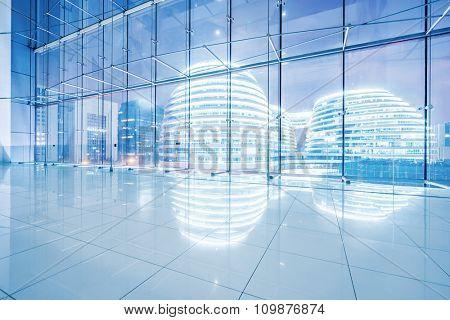 night scene of modern buildings through windows