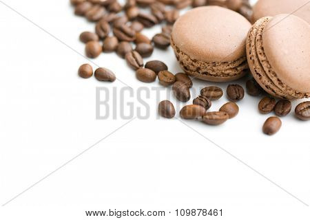 french macarons and coffee beans on white background