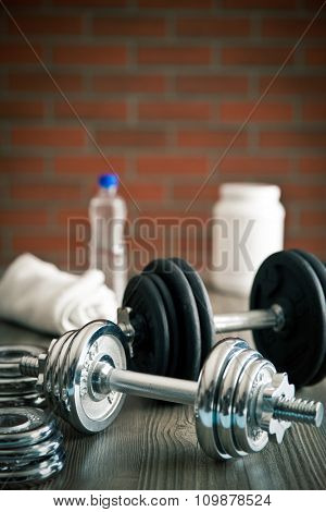 iron dumbbells on old wooden background