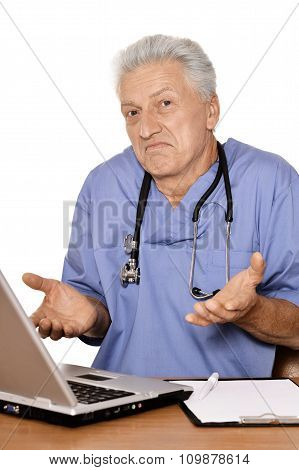 Senior doctor with notebook