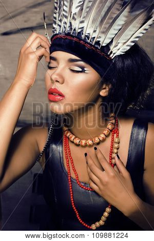 young pretty woman with make up like red indian halloween outfit