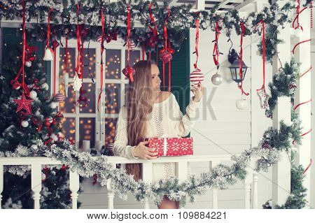 Beauty fashion woman with Christmas gift box, new year tree background