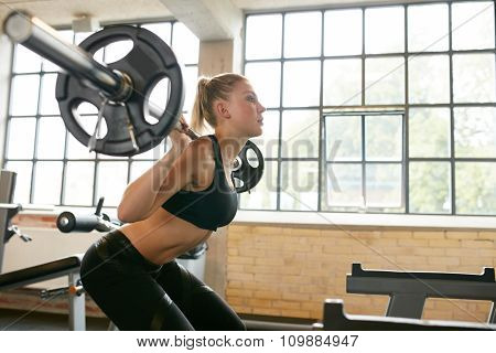 Woman Doing Squats In Fitness Club