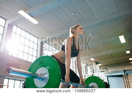 Young Female Weightlifter Focusing Before The Lift