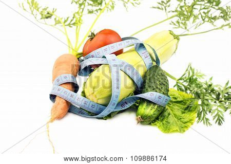 Various Vegetables Wrapped In Measuring Tape