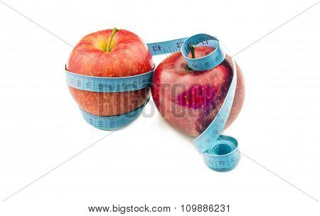 Red Apple Wrapped In Measuring Tape