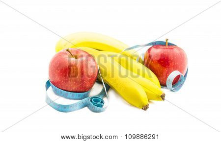 Banana And Apple Wrapped In Measuring Tape