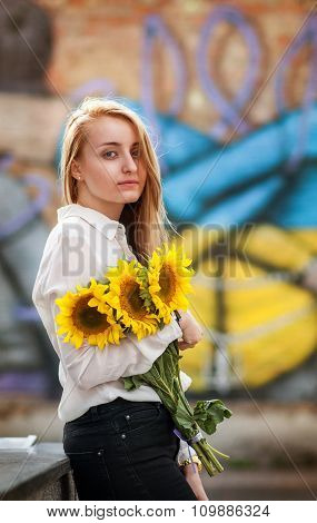 Deautiful girl with sunflower at outdoor