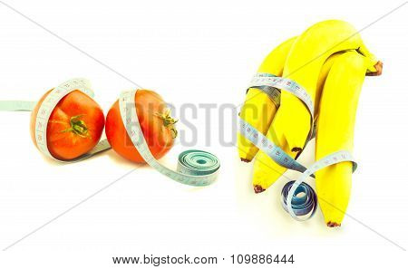 Red Tomato And Banana Wrapped In Measuring Tape