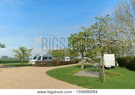 Campground with caravans and mobile homes in spring
