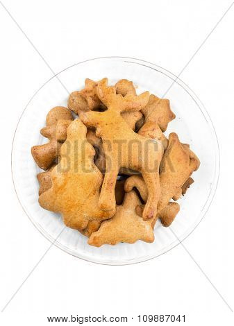 Christmas gingerbread cookies in glass bowl on white background