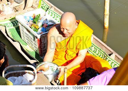 Nonthaburi, Thailand - November 25 : Buddhist Monk Is The Alms On Morning At Sai Noi Floating Market