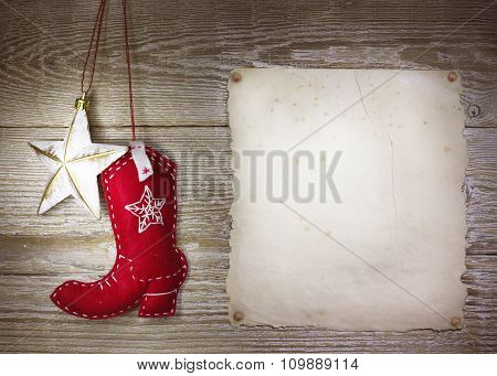 Cowboy Christmas Background With Western Toys Boot And Star On Old Paper Texture