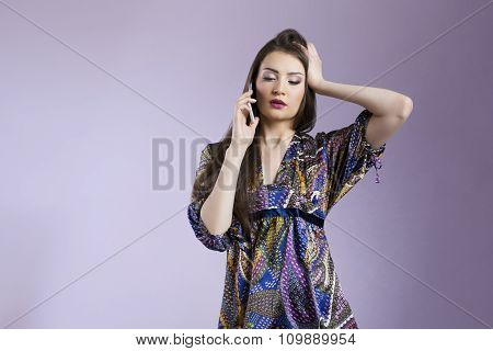 Upset woman talking on the phone