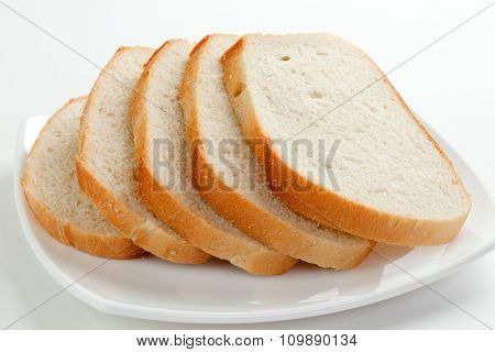 Sliced white bread on a plate