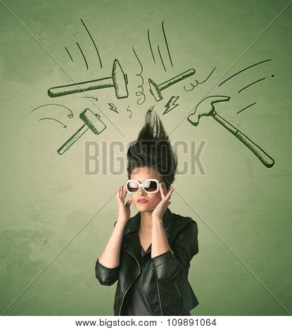 Tired woman with hair style and headache hammer symbols concept on background