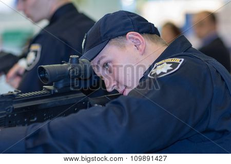 Kiev, Ukraine - September 22, 2015: Police Are Exploring New Models Of Weapons At The Specialized Ex