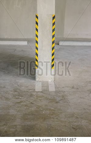 The warning strips in the corner pole of the parking