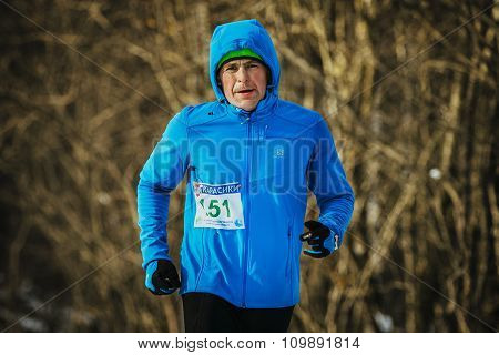 closeup middle aged male runner dressed for winter