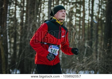 young athlete running in winter Park