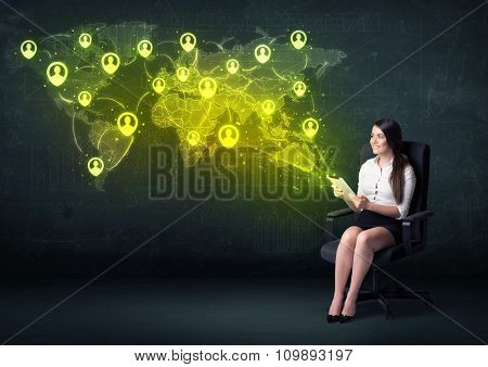 Businesswoman in office with tablet and social network world map concept on background