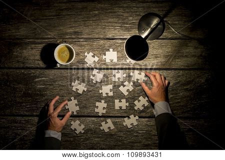 Top View Of Male Hands In Elegant Business Suit Trying To Find A Solution To A Problem By Arranging