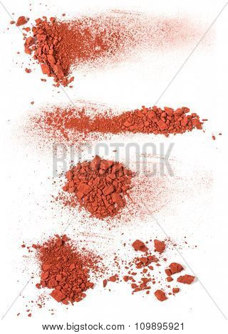 The handfuls of brown ground  isolated on the white background
