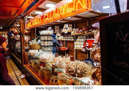 Christmas Market Stall With People Admiring Christmas Sweets