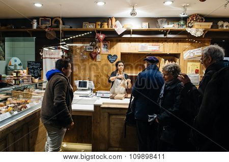 People Buying Bread And Pastry At French Bulangerie